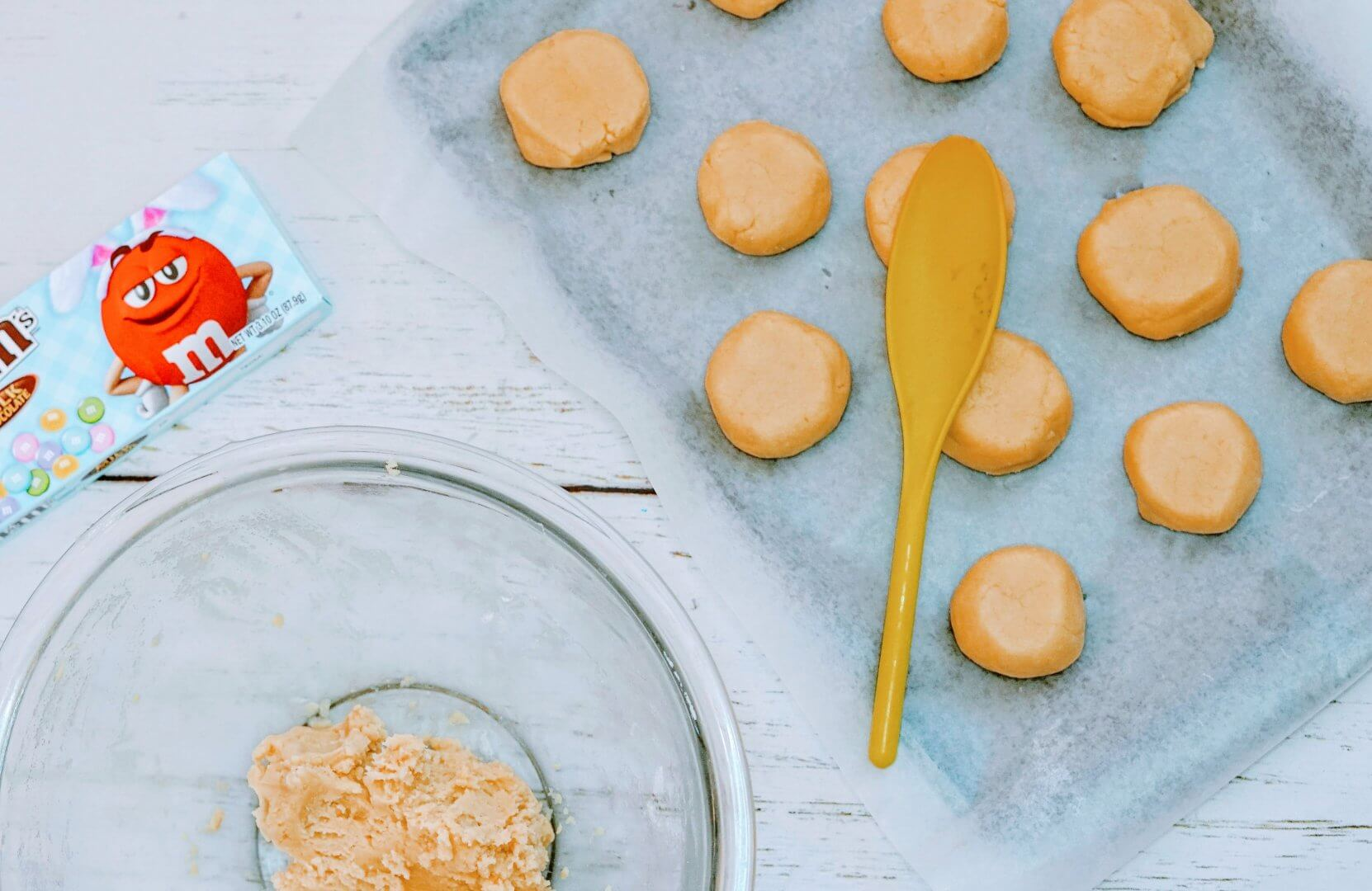 Decorating Sugar Cookies with Chocolate Candies on Baking Sheet