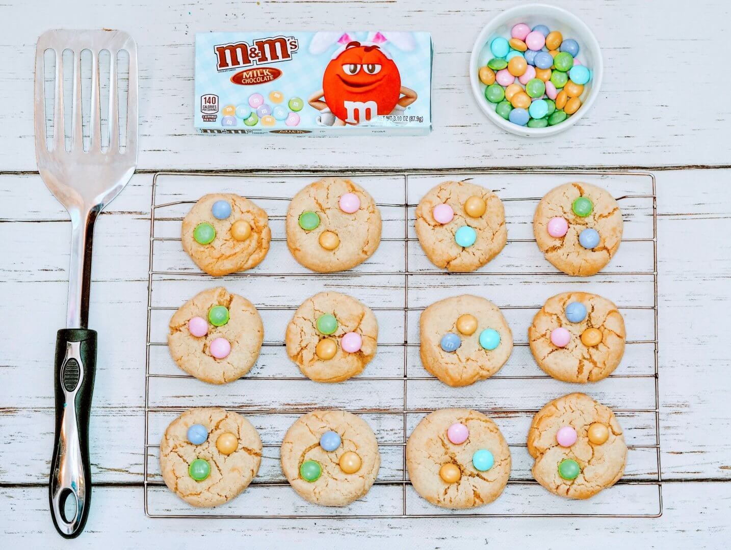 Decorating Sugar Cookies with Chocolate Candies on Cooling Rack